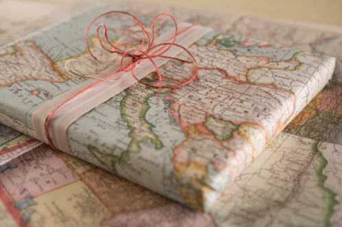 http://ramshackleglam.com/blog/home/maps-as-gift-wrap/
